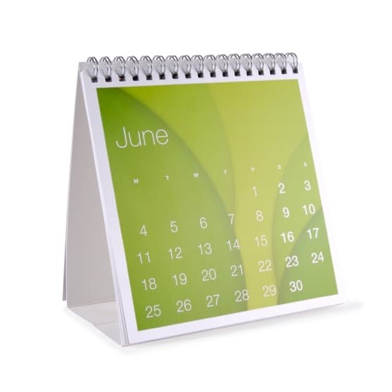 The month on June on a desk top calendar isolated on white...Note to inspector, model release attached, I created this calendar for the purpose of stock photography, it is not derivative of another work.